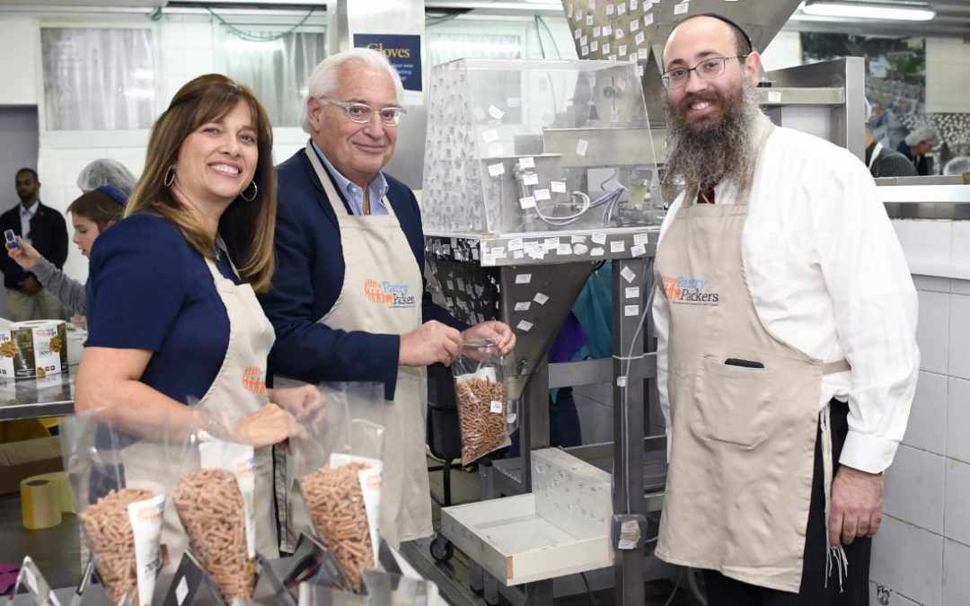 U.S. Ambassador to Israel Joins in Packing Staples for the Needy