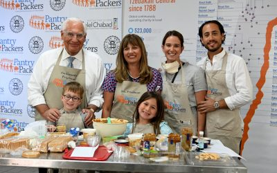 US Ambassador Friedman, family make thousands of Shavuot cheesecakes for elderly
